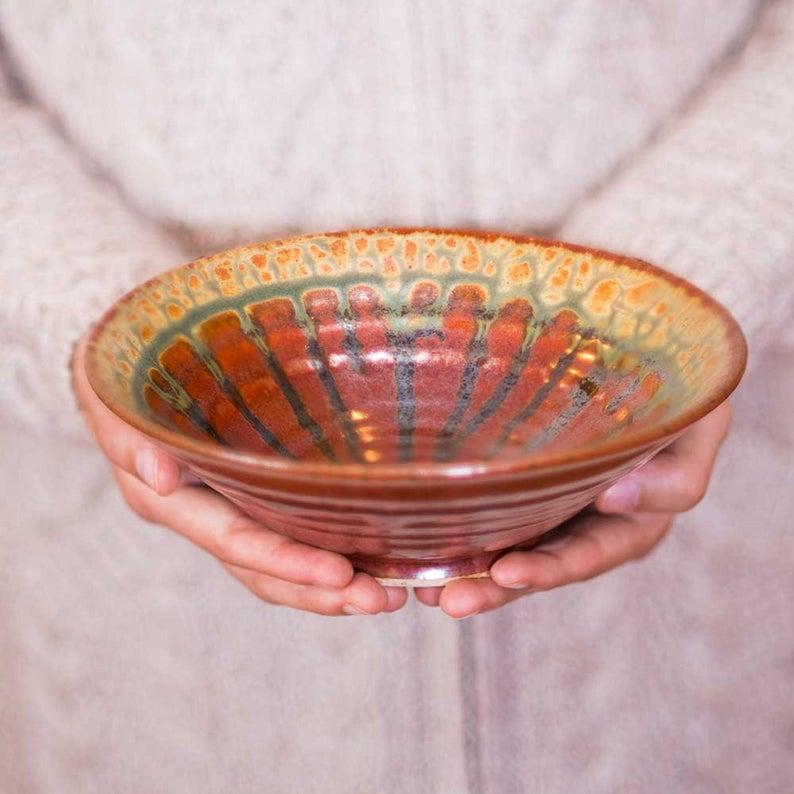 red handmade ceramic bowl