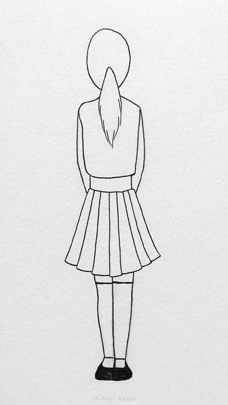 girl facing away drawing
