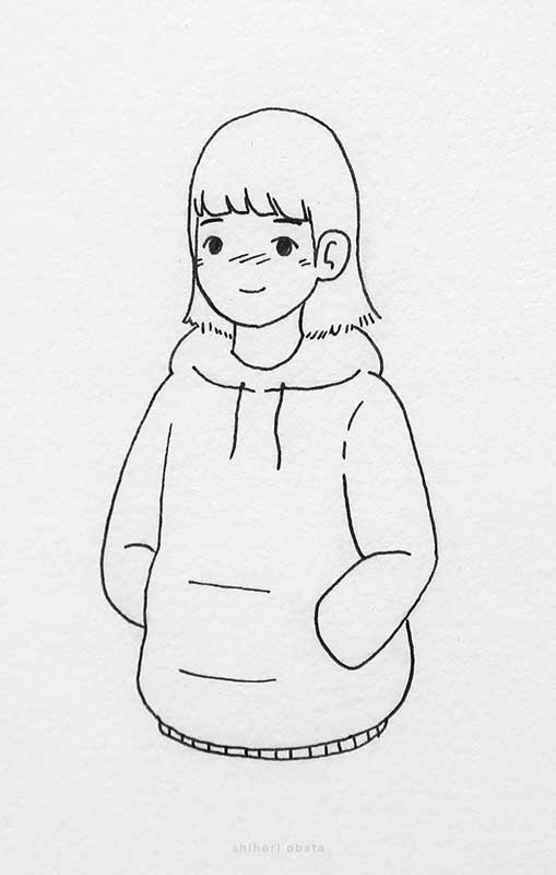 girl wearing hoodie drawing