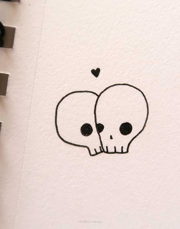 kissing skulls drawing