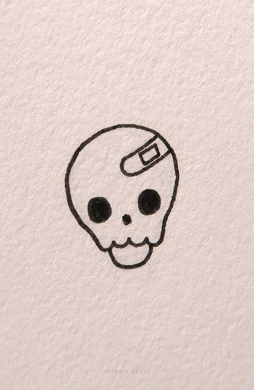 bandaid skull drawing